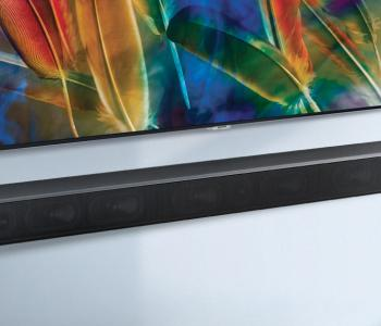 image of a tv with a soundbar underneath it. both the tv and the soundbar are mounted to a wall