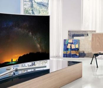 image of a curved tv inside a furnished house