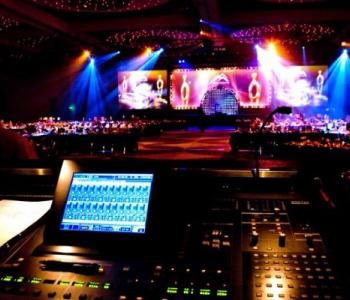 image of a computer managing lighting from above a lit stage inside of a theater
